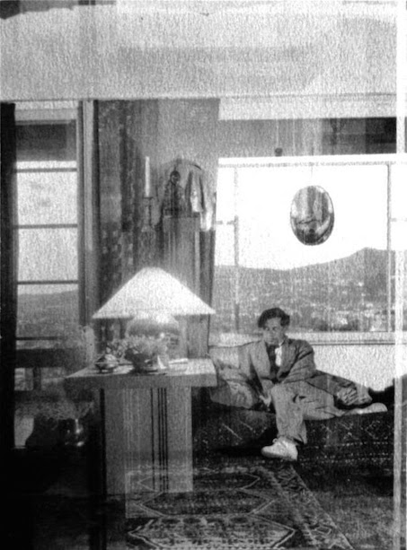 Herman Sachs in his living room in the Owner's Unit at Manola Court, seated on a Schindler designed sofa next to a Schindler designed end table. Photo courtesy of Stephen Clauser, handler of the artist Pasquale Giovanni Napolitano's Estate.
