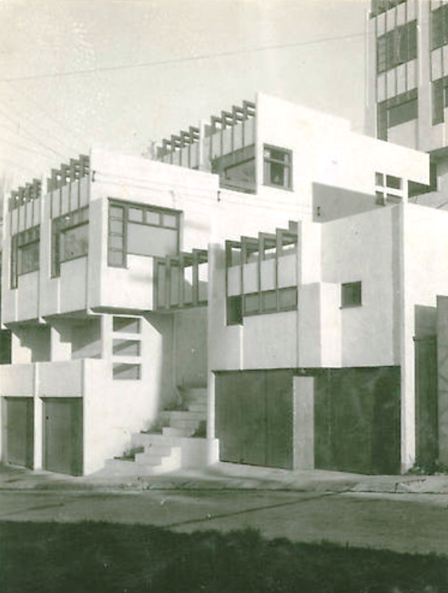 Three of the Manola Court apartment units and the corresponding garages. Photo published in American Home in 1942.