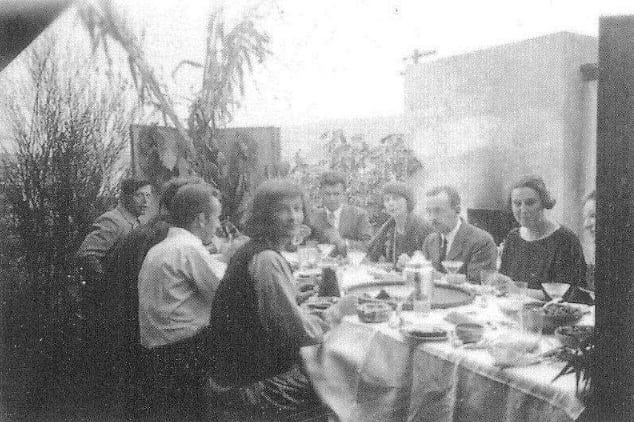 "1923 photo of Thanksgiving at Kings Road, likely taken by R.M. Schindler. The photo illustrates the mutual Chicago-Los Angeles connections that Schindler and Sachs (far left) had, such as Betty Katz (seated front center facing the camera) and her future husband - architect and Schindler collaborator Alexander ""Brandy"" Brandner (seated to her left). Following the death of Sachs in 1940, Katz and Brandner bought Sachs's apartment building and lived in the penthouse for three years until their new ""Brandy"" designed house at the end of the street was complete. Photo courtesy of Professor David Gebhard's Architecture and Design Collections at UC Santa Barbara. ⁠ ⁠ #sachsapartments #hermansachs #manolacourt #rmschindler #rudolphschindler #schindler #vintagephoto #archivalphoto⁠"