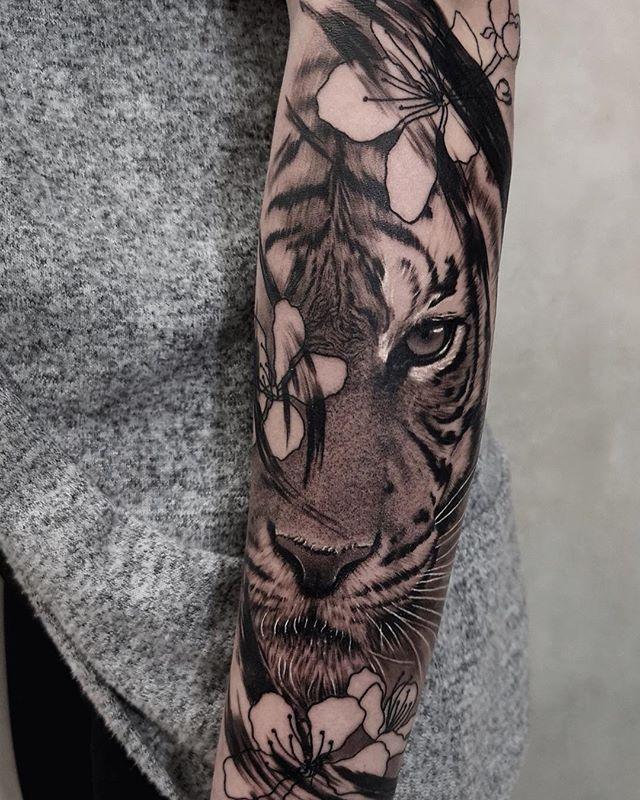 """The world is a jungle"" • Tattoo Artist: @felipe.tattart #BambooTattoo #realistictattoos • • • #torontotattooshop #tattoostoronto #torontotattoos #tattootoronto #torontotattooshops #torontotattoostudio"