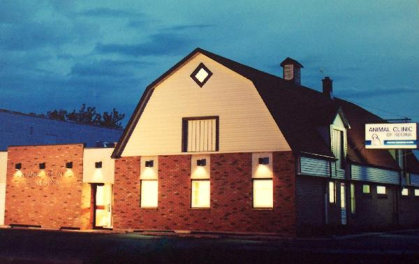 What Animal Clinic of Regina's building looked like with brick and aluminum siding before it was painted red