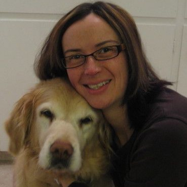 Dr. Jennifer Jinks and her golden dog