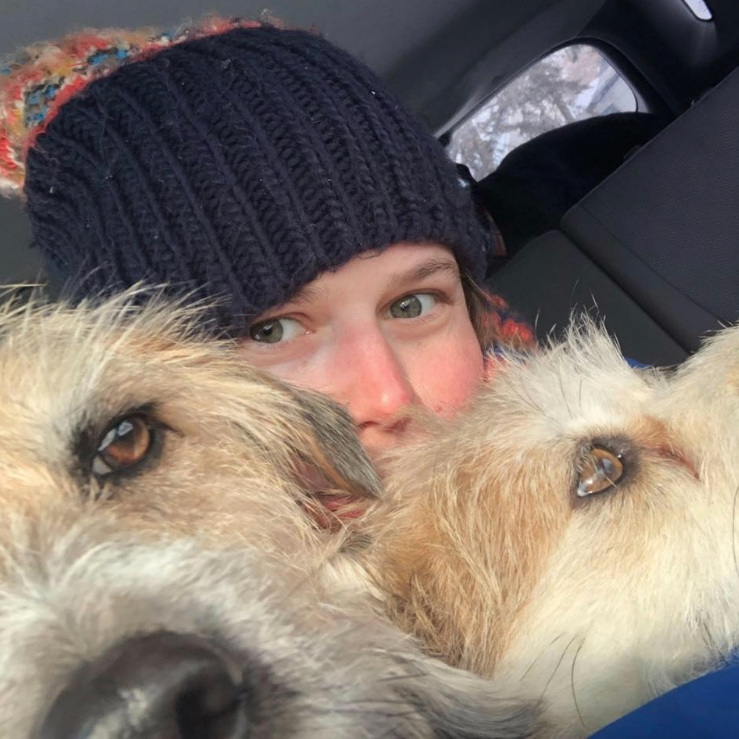 Darcy McIntyre with two dogs