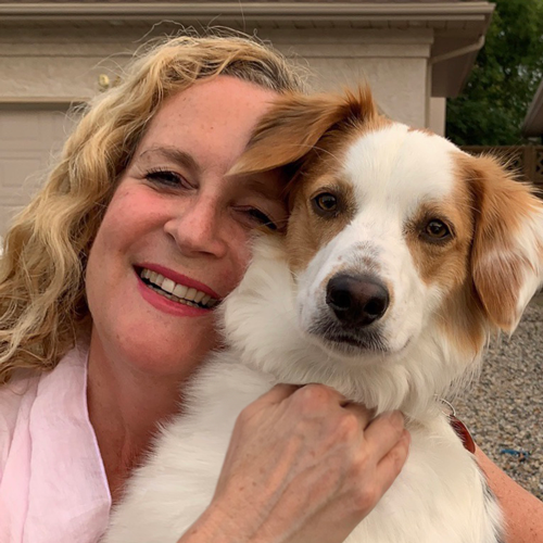 Dr. Lesley Sawa with her her white and tan dog