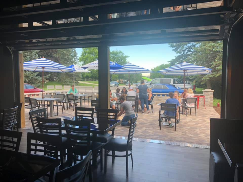 Perfect Patio! Come see our unique garage doors and enjoy a summer night on our patio!