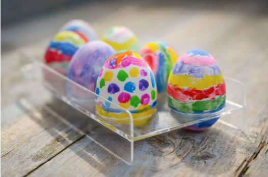 No need for messy dyes—have kids hand draw or paint their Easter eggs this year.