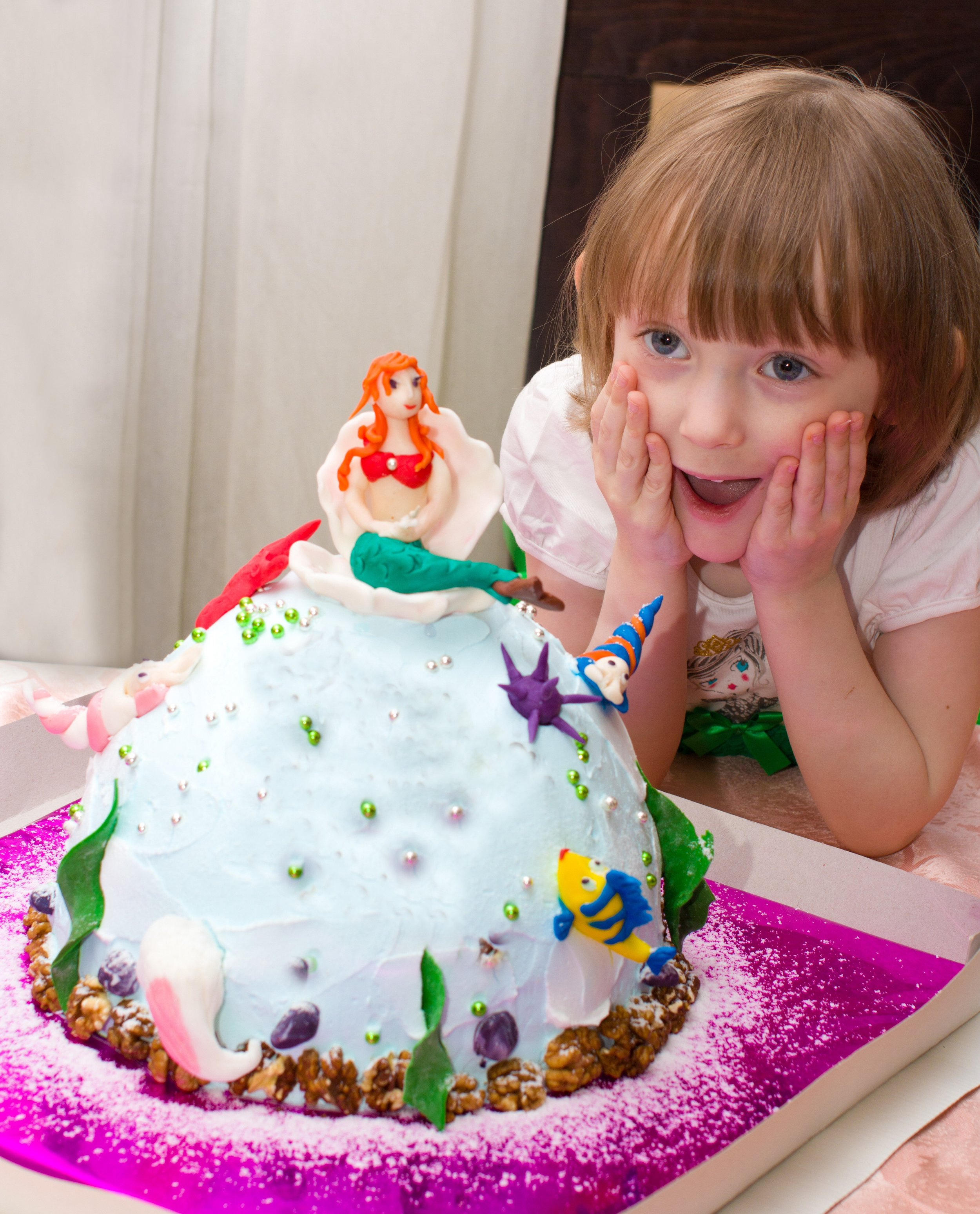 A DIY Little Mermaid birthday cake has made this little girl very happy! | LYFETYMES is your #1 party planning website and we rounded up the BEST mermaid birthday party ideas.