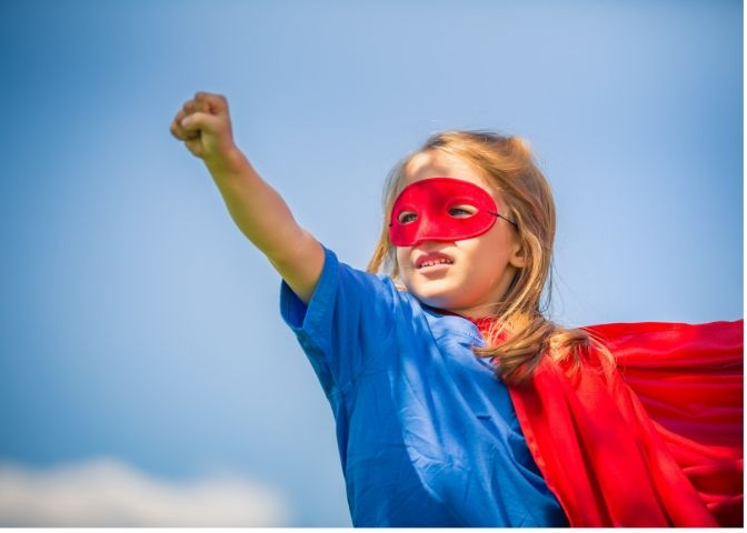 girl dressed as super hero in red and blue