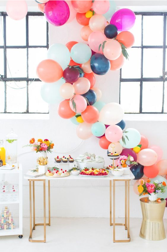 pink, peach, blue, and mint balloon garland for a baby shower