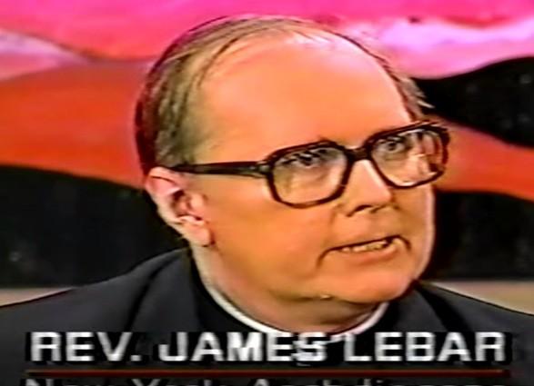 Laurence Harvey is Reverend James LeBar.
