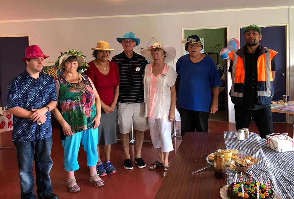 Whakatane members celebrating the founder of TimeBank, Edgar Cahn's birthday on 23 March 2019 with a hat competition at Pou Whakaaro.