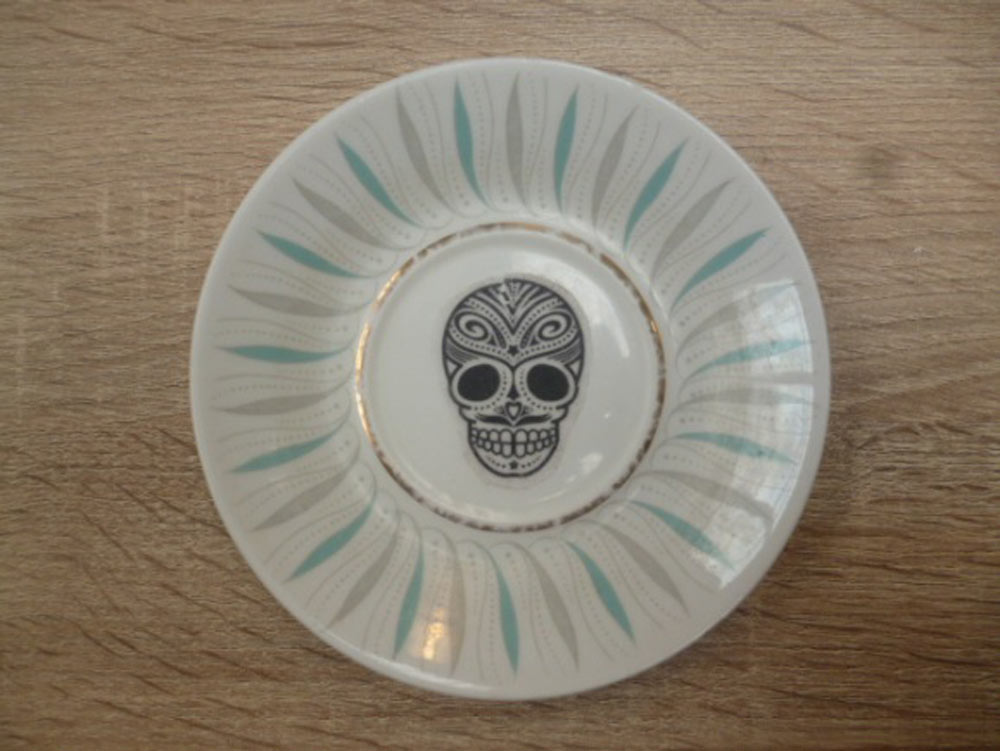 Upcycled saucer by Claire Pye