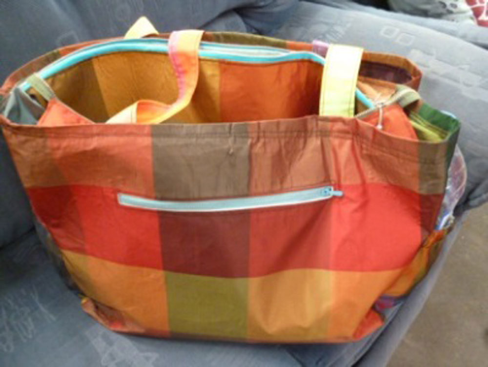 Upcycled bag using salvaged curtain fabric and 2nd hand zip by Katie Tua