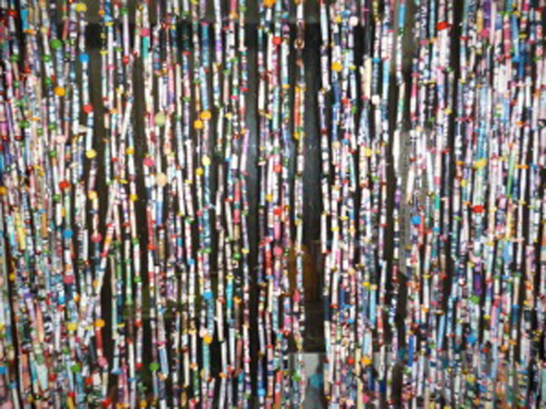 A beaded curtain made from pages of magazines at a Pou Whakaaro workshop