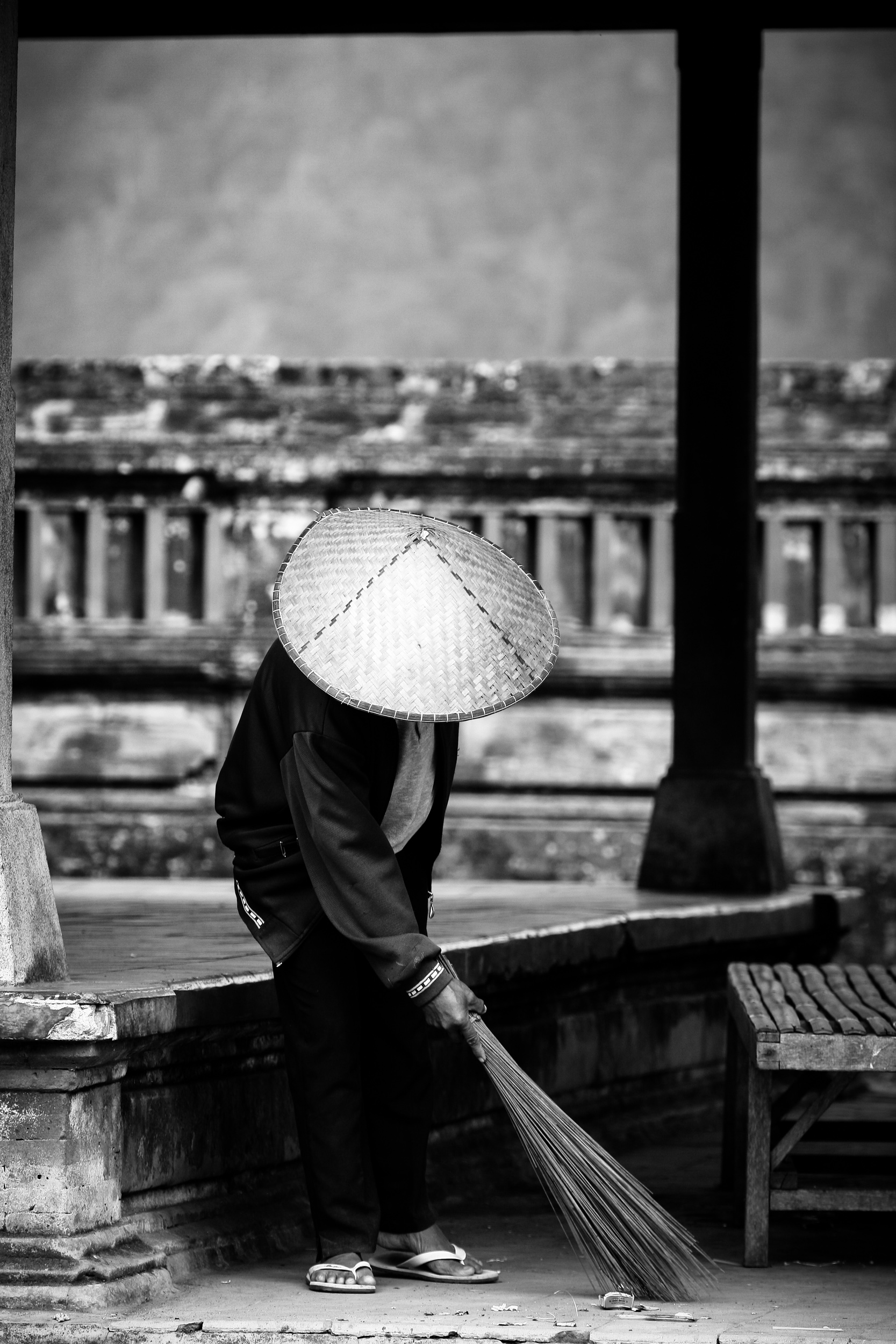 Old man working in the temple, Bali, Indonesia