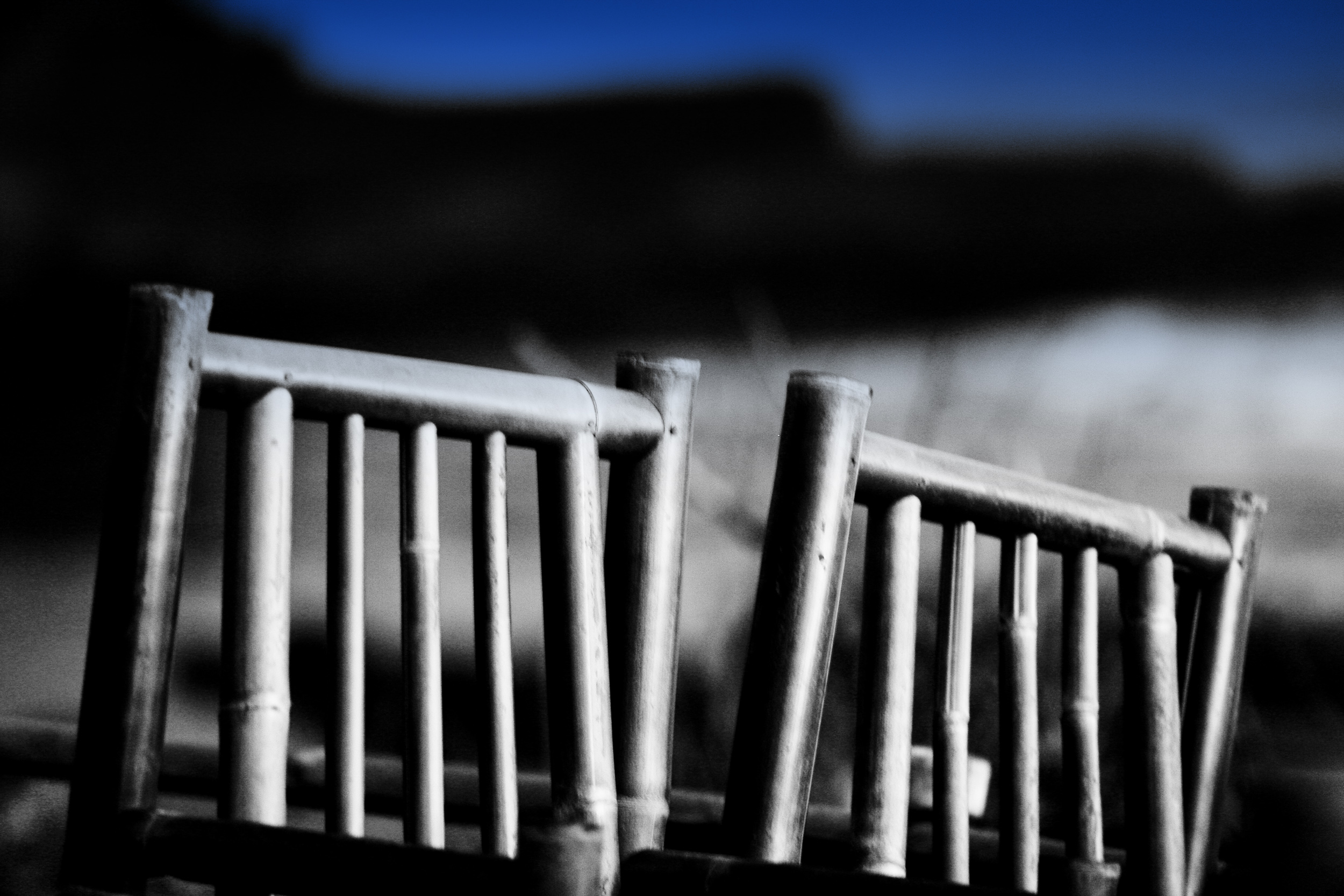 Bamboo chairs along the beach, Tanah Lot, Bali Indonesia