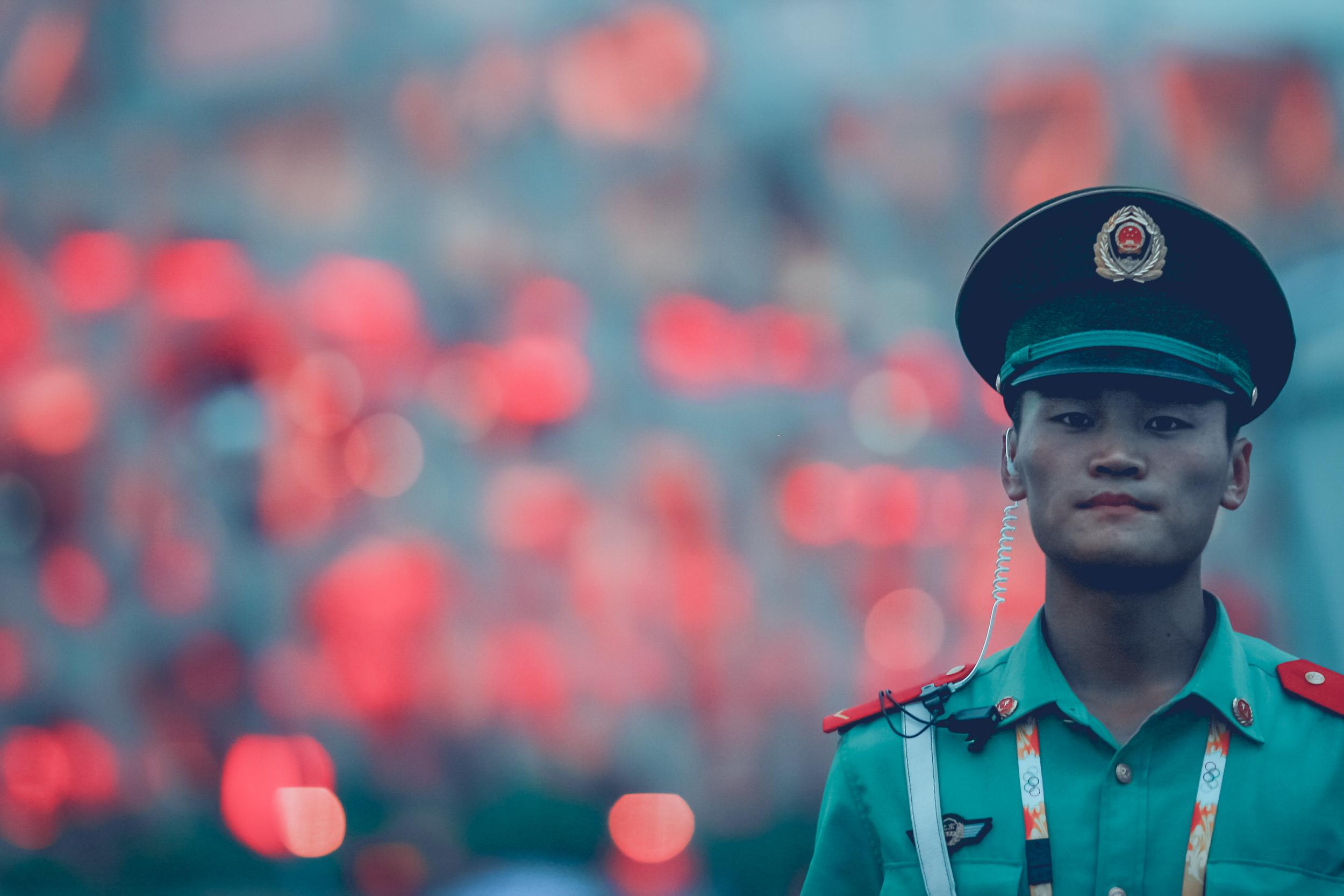 soldier in front of birds nest_Beijing Olympic