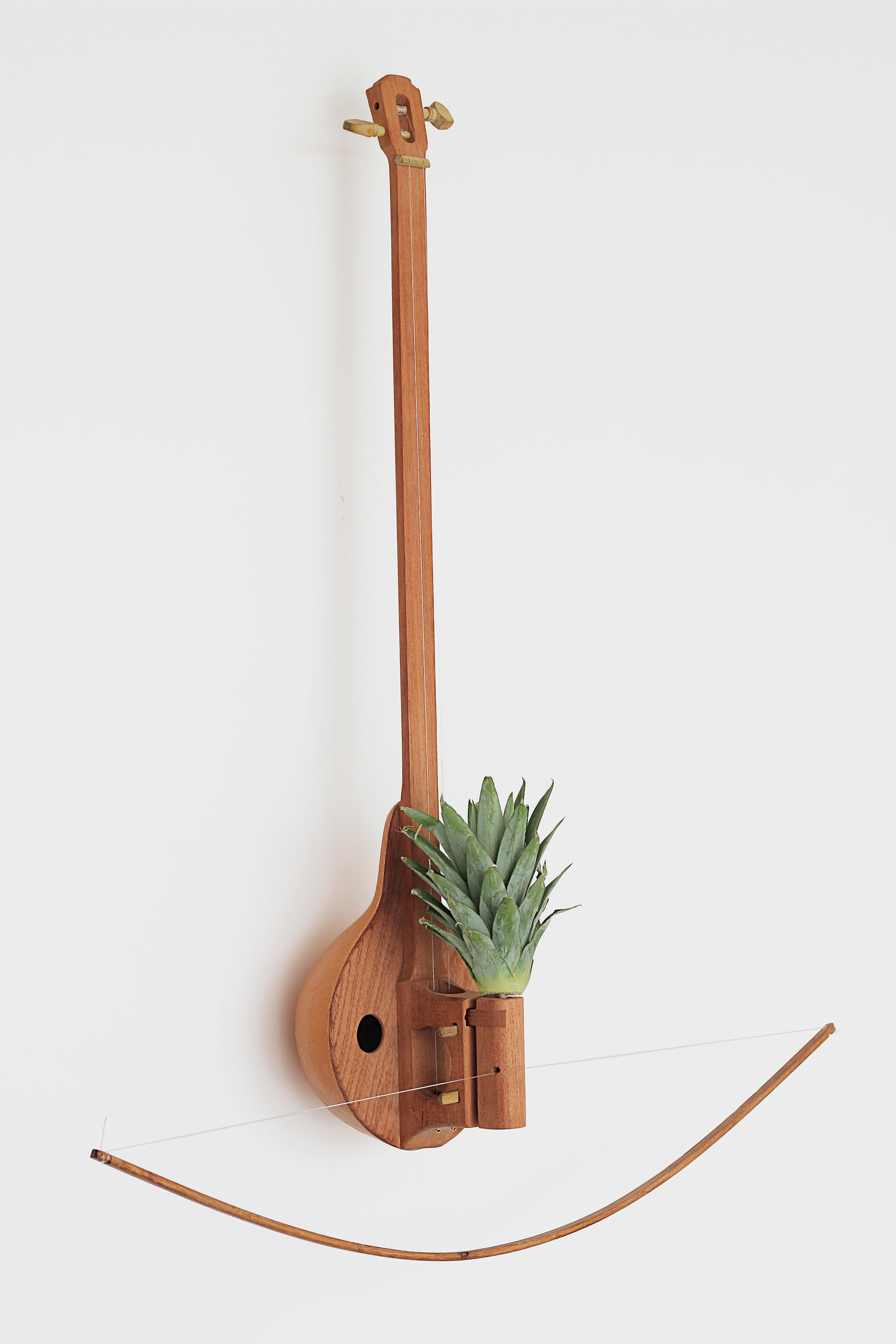 - Each instrument is made with wood, a gourd, strings & a pineapple topSmallest Instrument: 60cm x 20cm x 18.5cm Largest Instrument: 118cm x 33cm x 28cm