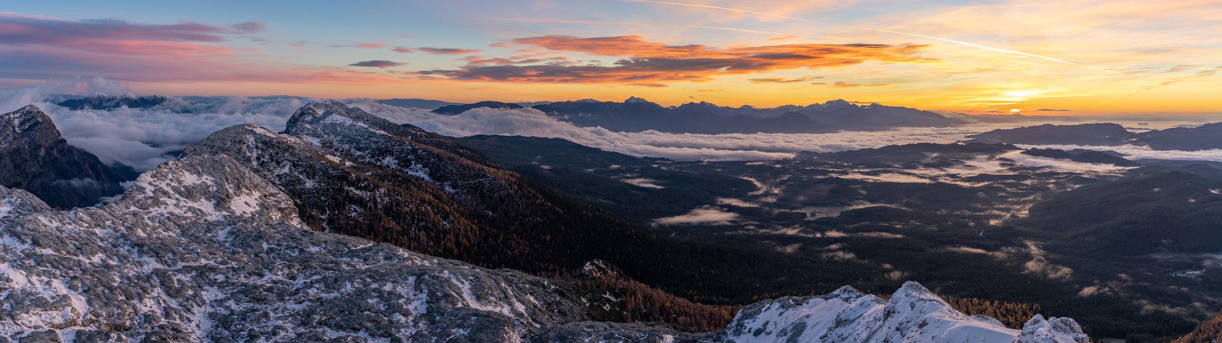 Panoramic view from Mt. Viševnik (2050 m) towards the forests of Pokljuka and the Kamnik-Savinja Alps.