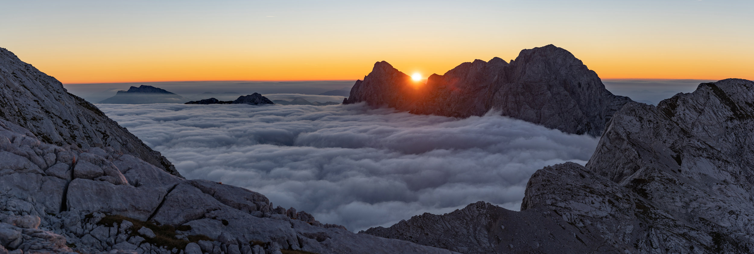 Fog in the Logar Valley and sunrise behid Mt. Ojstrica (2350 m) in the Kamnik-Savinja Alps.