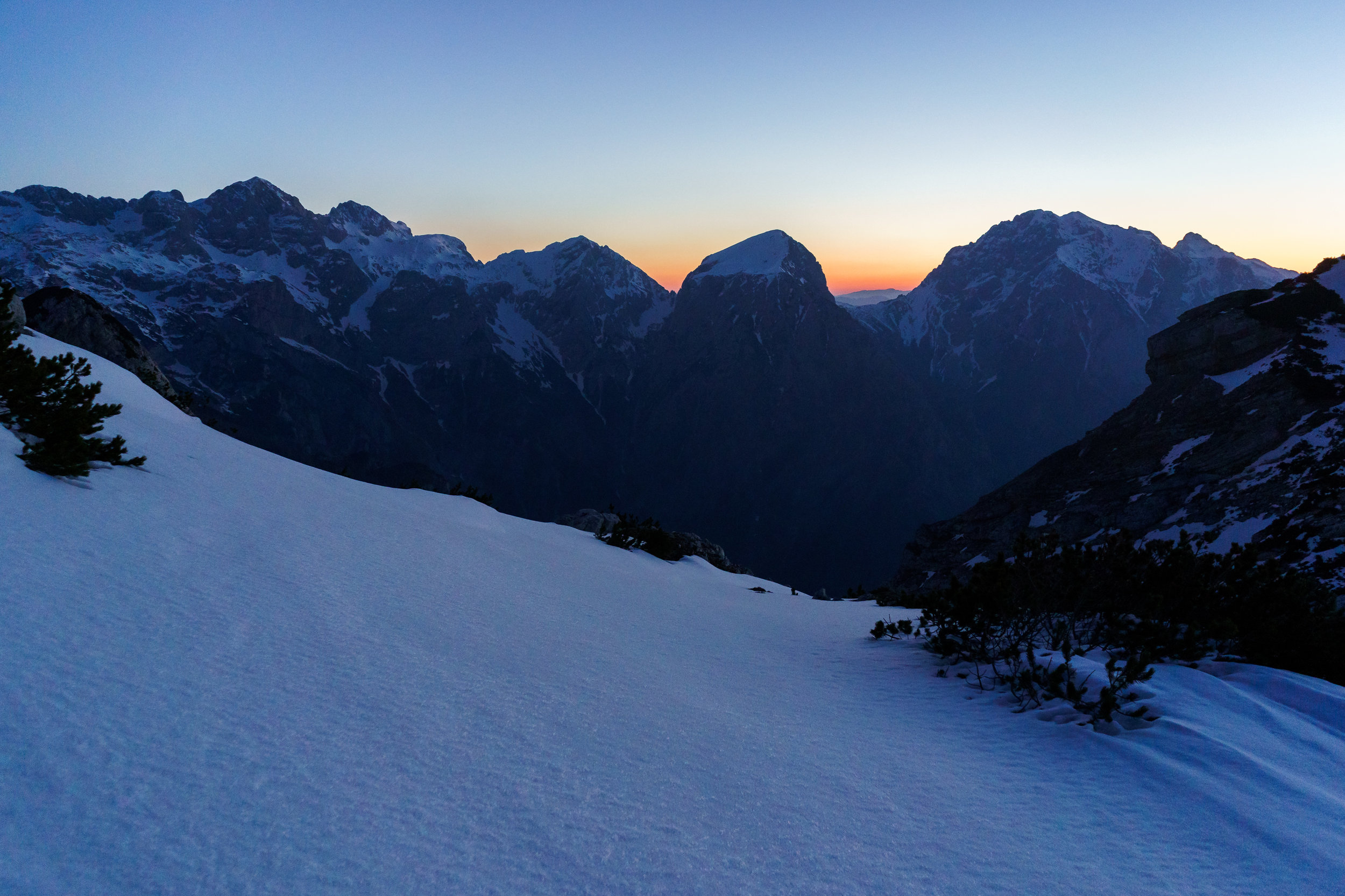 View towards the coming sunrise. The standout summit in the middle is Mount Brana.