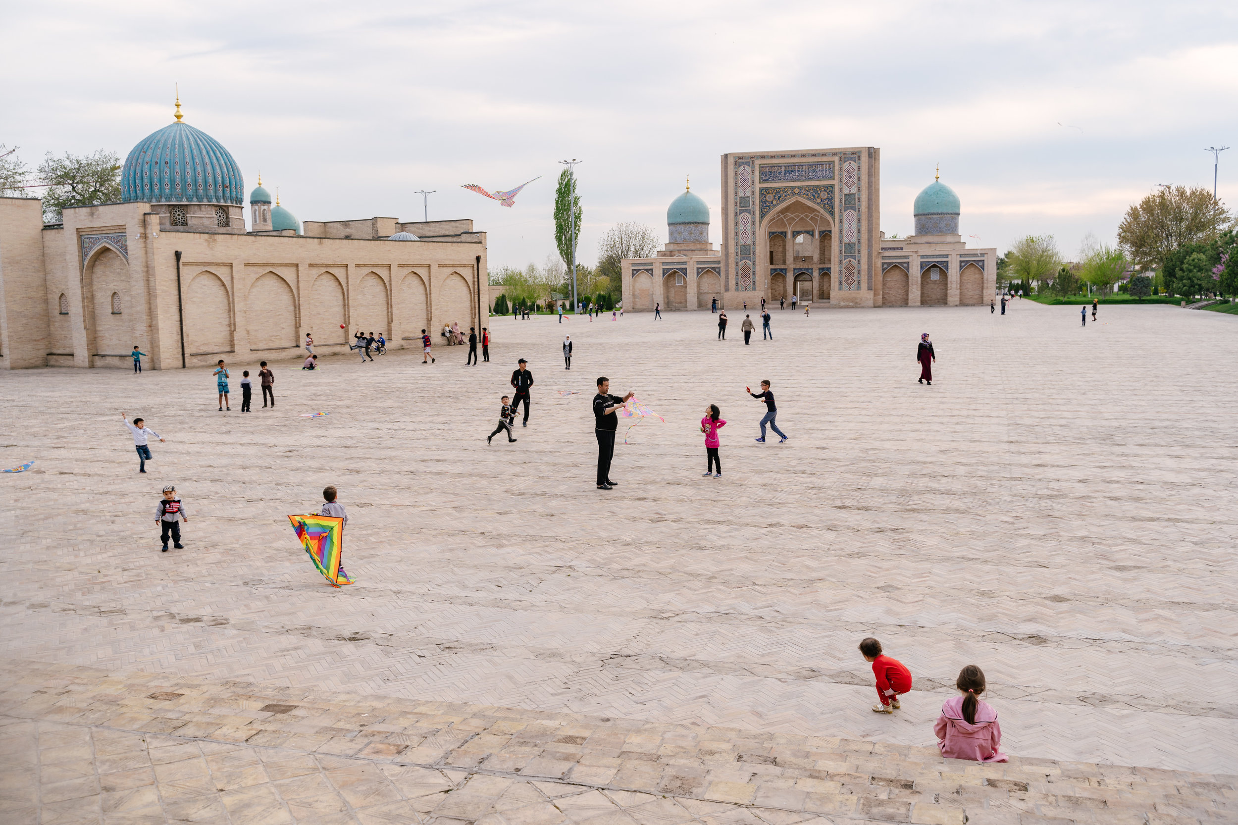 Sunday afternoon at Khast Imam Square. Kite flying is a major free time activity in the Middle East and Central Asia.