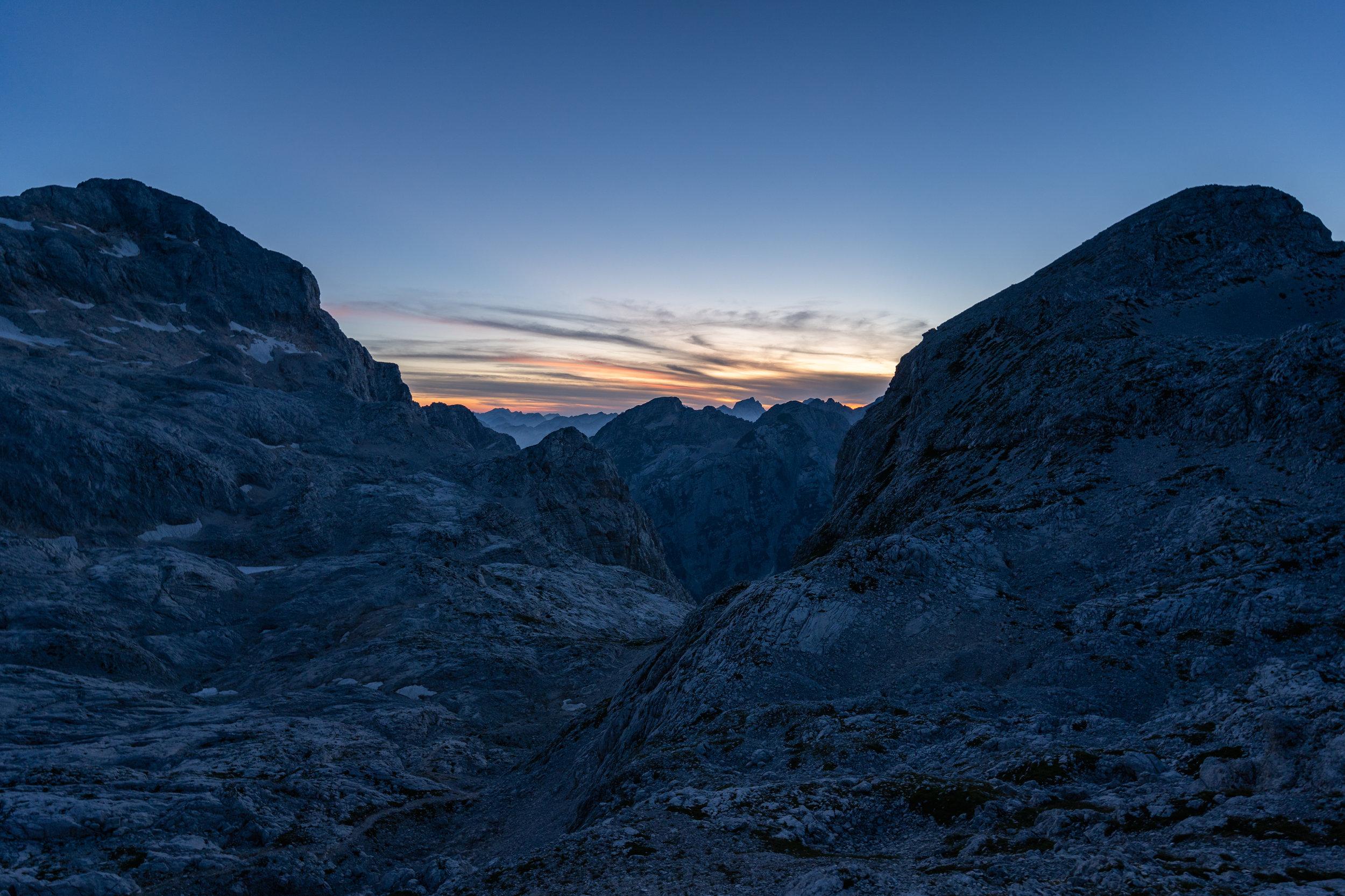Evening at the mountain hut, looking towards Mt. Triglav (left), Mt. Begunjski vrh (right) and Mt. Jalovec (back).