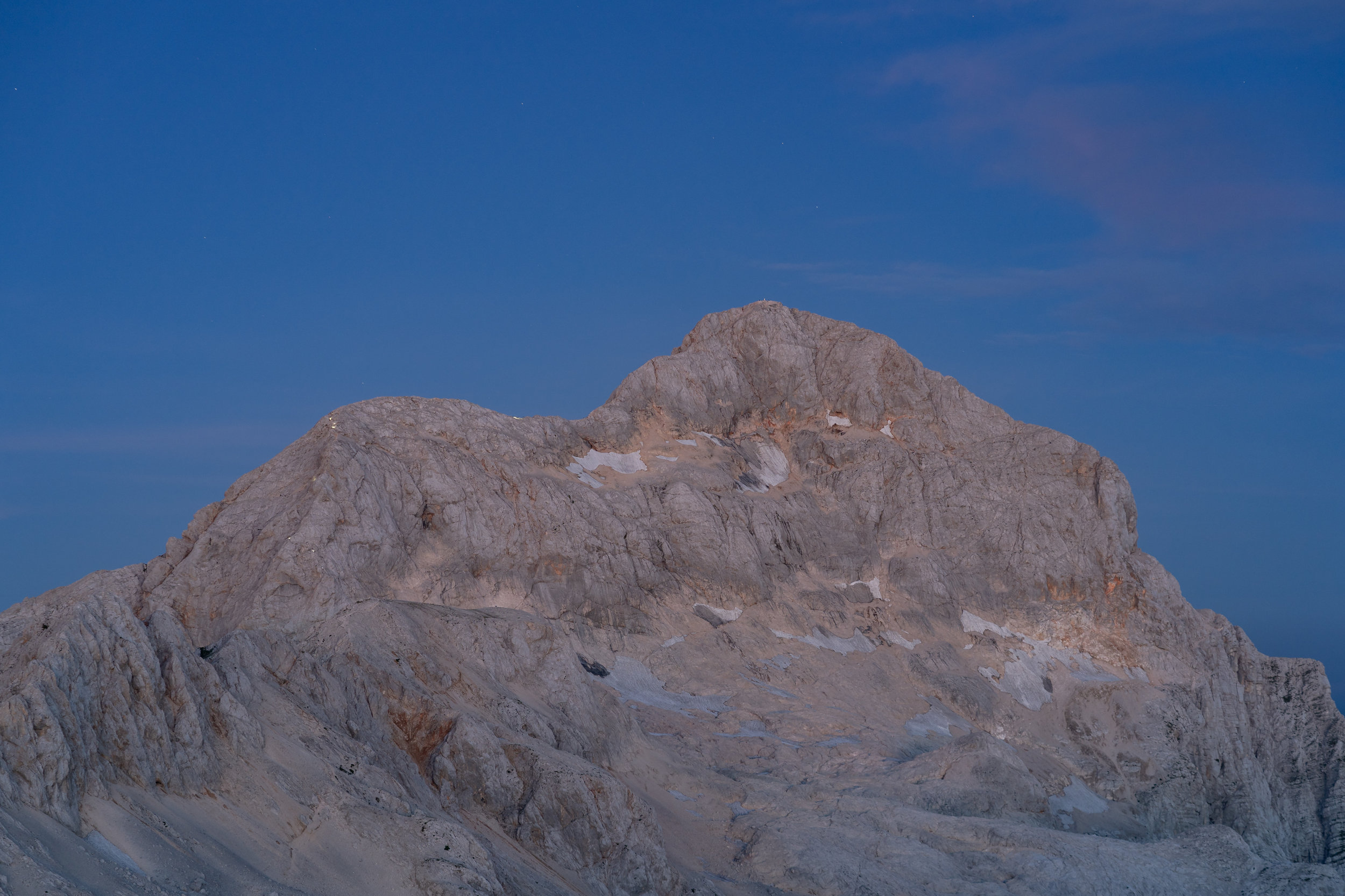 People climbing Mt. Triglav in early morning. Can you see the lights?
