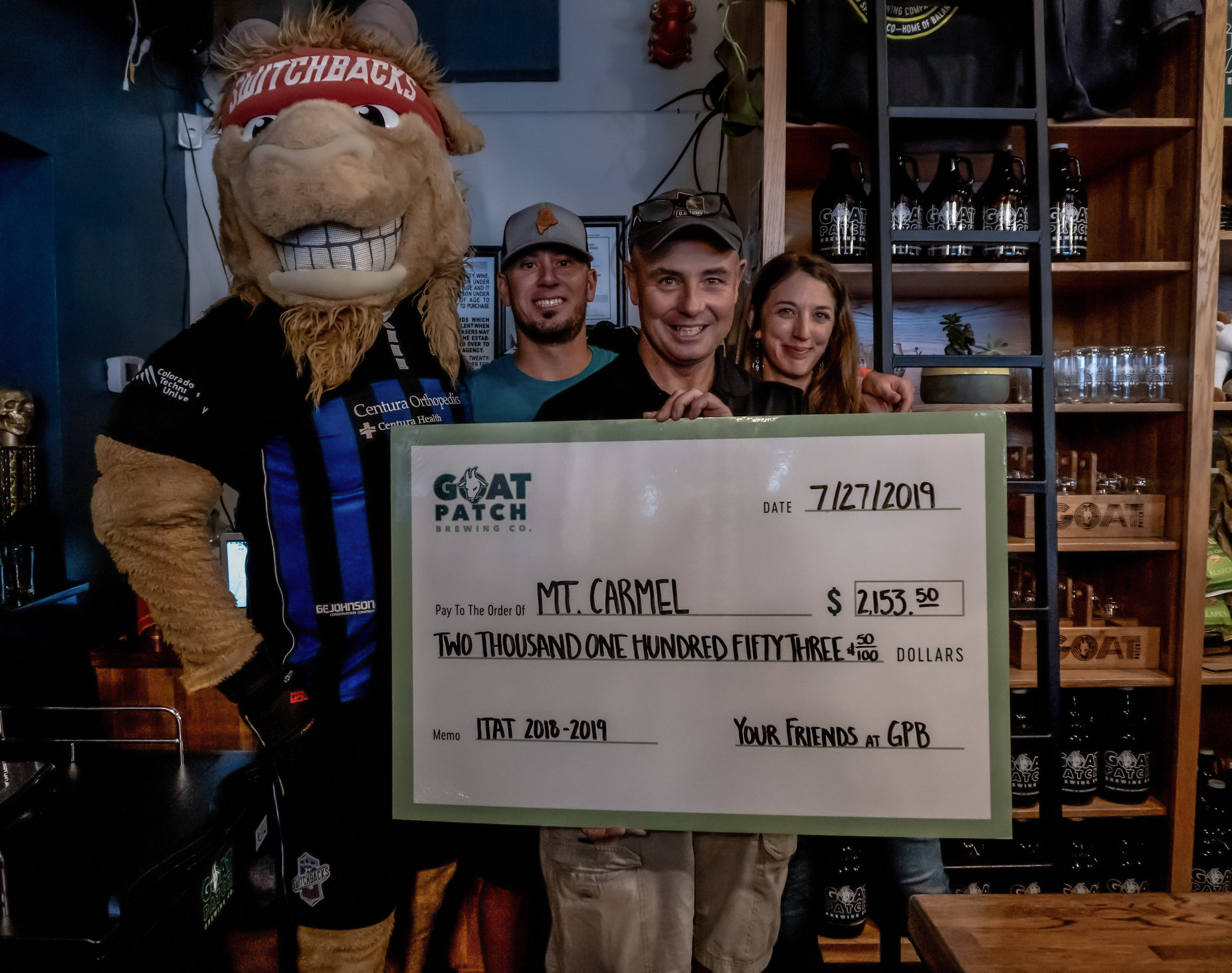Mt. Carmel also was presented with a check from the It Takes A Tribe Red Ale proceeds. Photo courtesy Goat Patch Brewing.