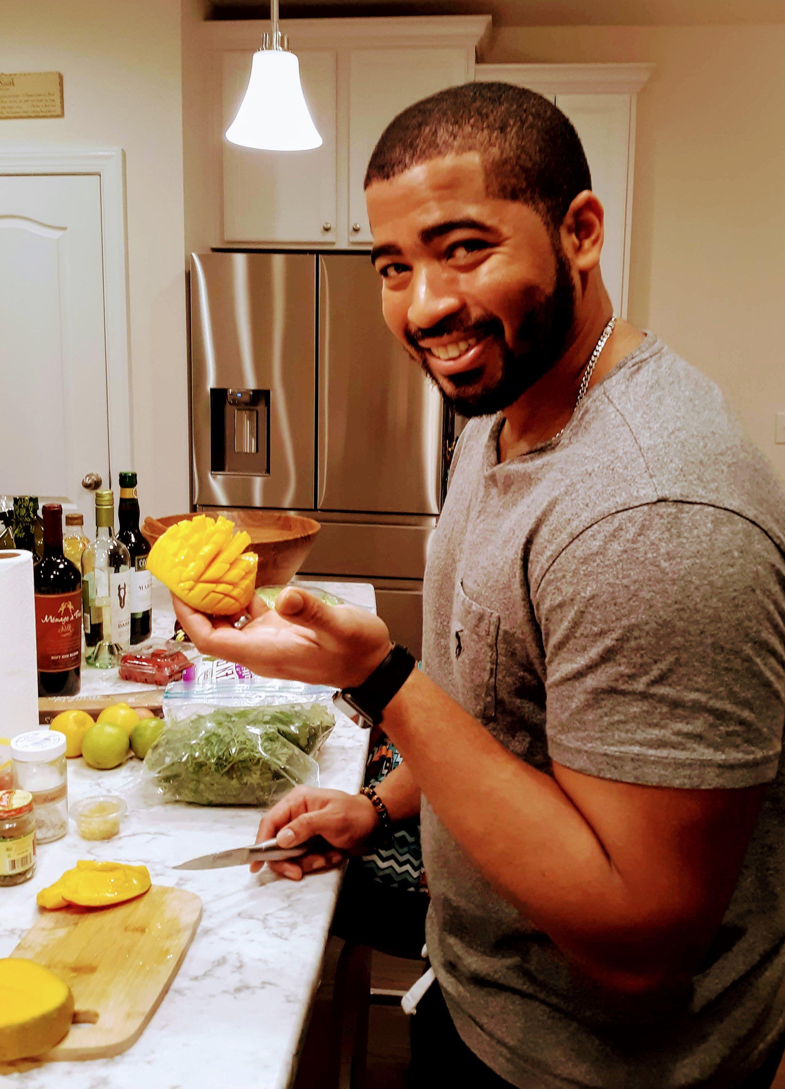 CIYN participant cutting mango.jpg