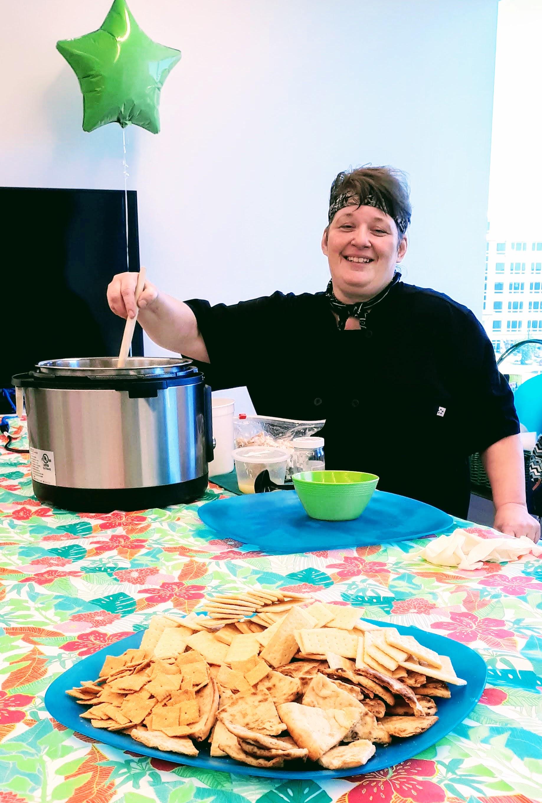 Zacki's terrific assistant Gigi preparing Avgolemono soup with lemon, egg yolks, brown rice and chicken.