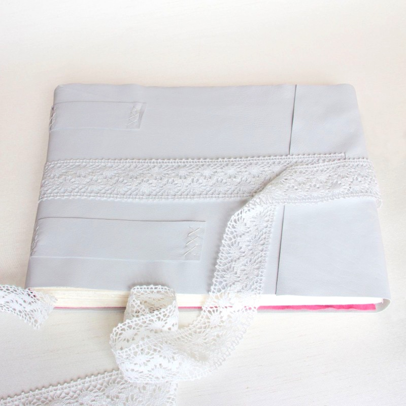 white leather wedding album with lace ribbon