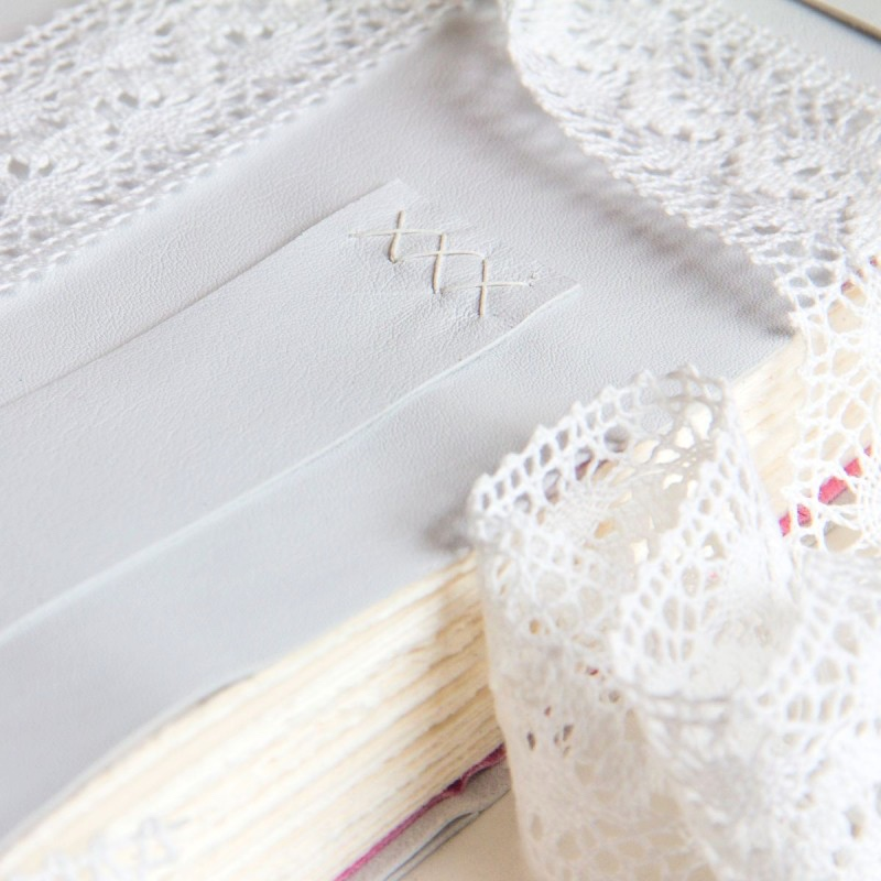 white leather wedding album with lace ribbon made in Ireland
