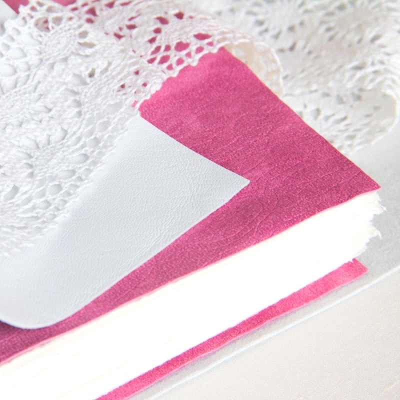 White leather with pink swede page of wedding album