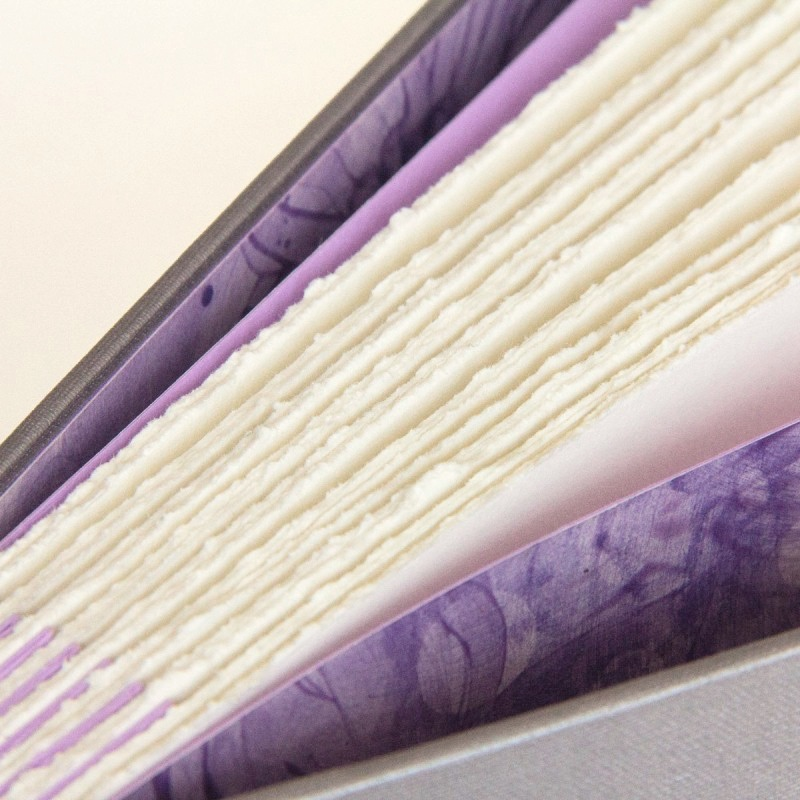 Torn edges of pages in handmade photo album book