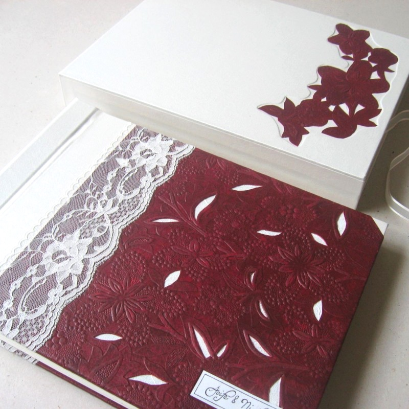 Traditional wedding album with white lace