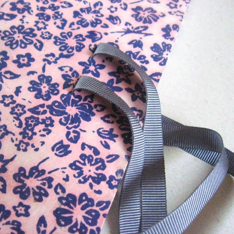 Silver grey ribbon on personalised wedding book