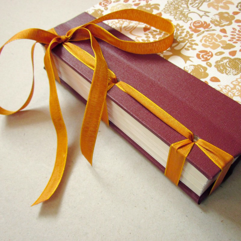 Handmade photo album book with orange ribbon and cover
