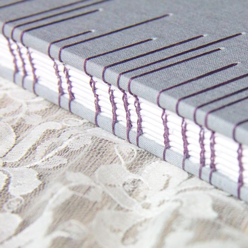 Hand stitched guest book using coptic stitch