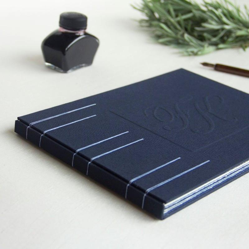 Elegant handmade guest book with handmade paper