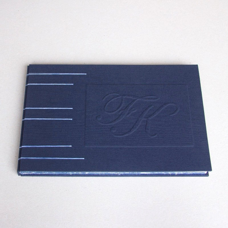 Unique guest book with couple's initial embossed on cover - creative guest book ideas