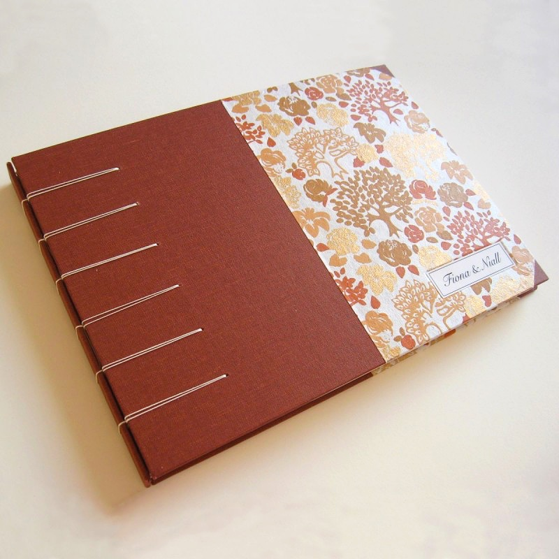 Orange cover of handmade wedding guest book