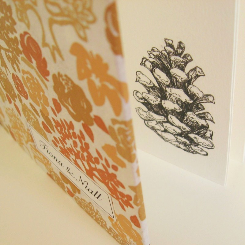 Pine cone drawing in elegant wedding guest book