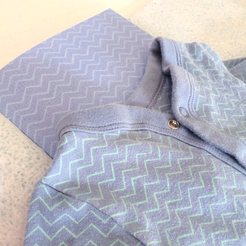 Baby grow pattern repeated in memory book pages
