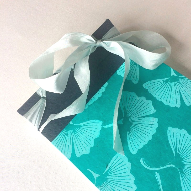 Turquoise handmade memory book of baby's first year