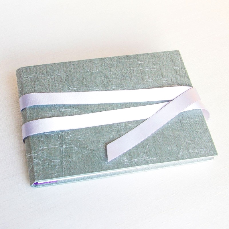 Silver green cover on handmade memory book
