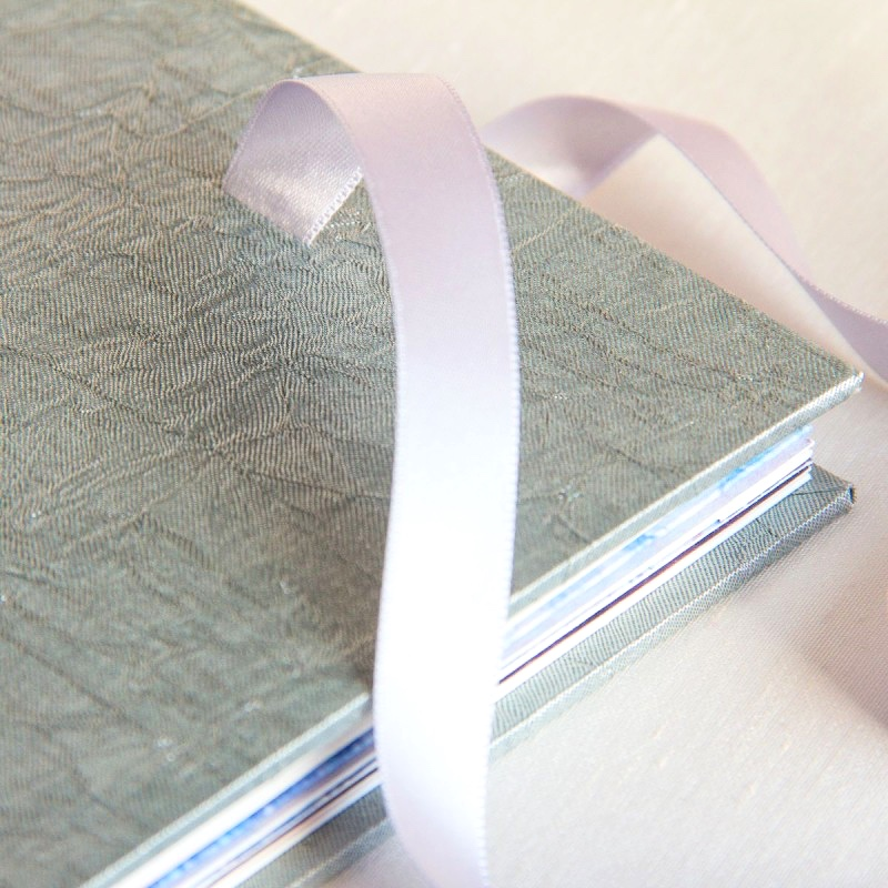 Silver ribbon tie on handmade memory book made in Ireland