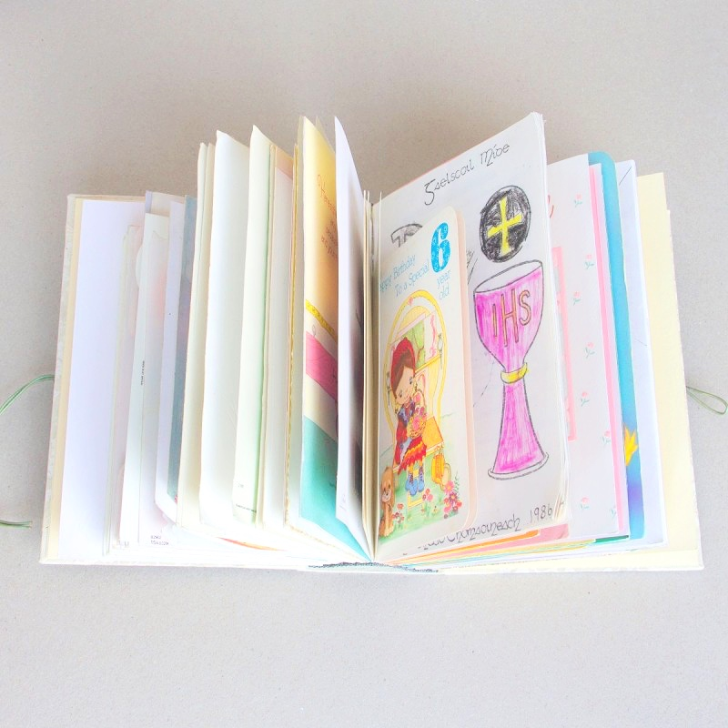 Birthday cards and other mementos in handmade memory book