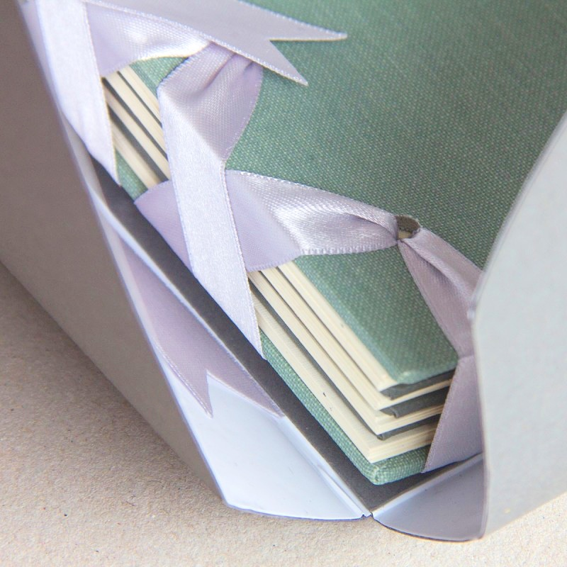 Close up of spine of hand crafted memory book album