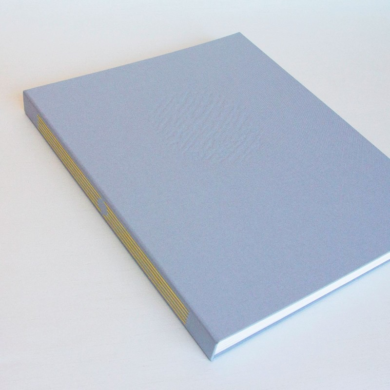 Handmade artist book with grey cover with yellow thread